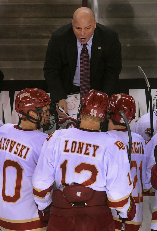 . DENVER, CO. - OCTOBER 12: Denver coach Jim Montgomery drew up a plan in the first period. The University of Denver hockey team hosted Merrimack at Magness Arena, Saturday night, October 12, 2013. Photo By Karl Gehring/The Denver Post