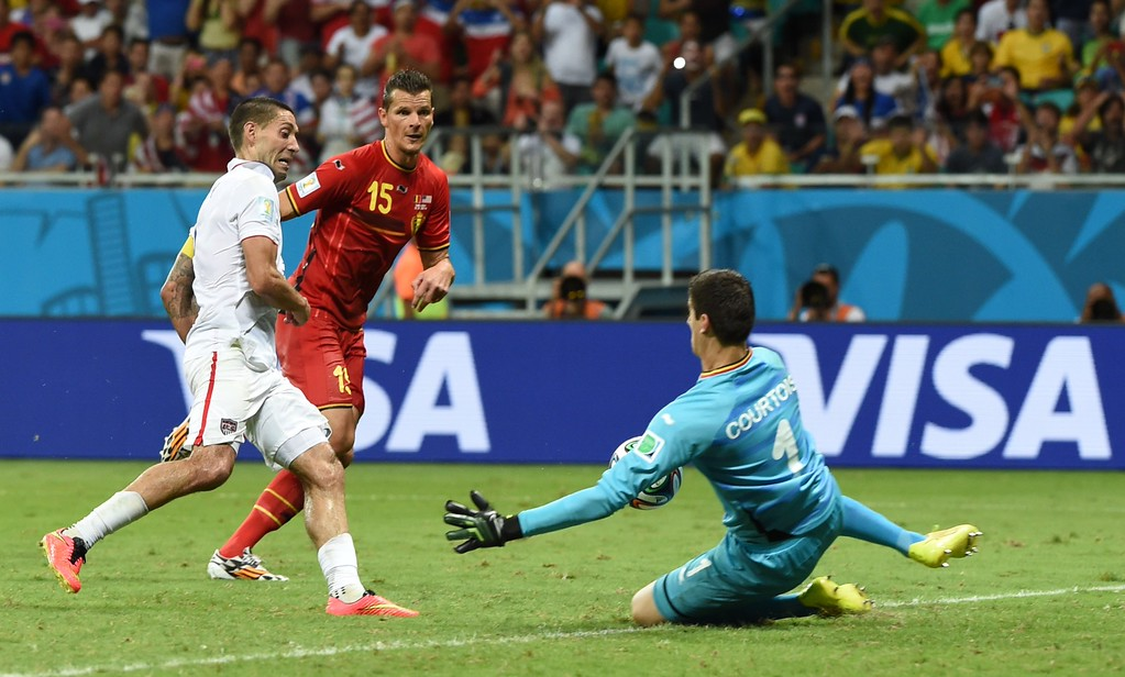 . Belgium\'s goalkeeper Thibaut Courtois (R) saves a shot by US forward and captain Clint Dempsey during a Round of 16 football match between Belgium and USA at Fonte Nova Arena in Salvador during the 2014 FIFA World Cup on July 1, 2014.      AFP PHOTO / FRANCISCO  LEONG/AFP/Getty Images