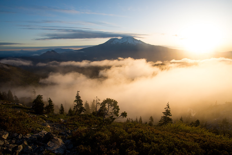 Mount Shasta sits above the clouds on a bright June sunrise in Northern California.