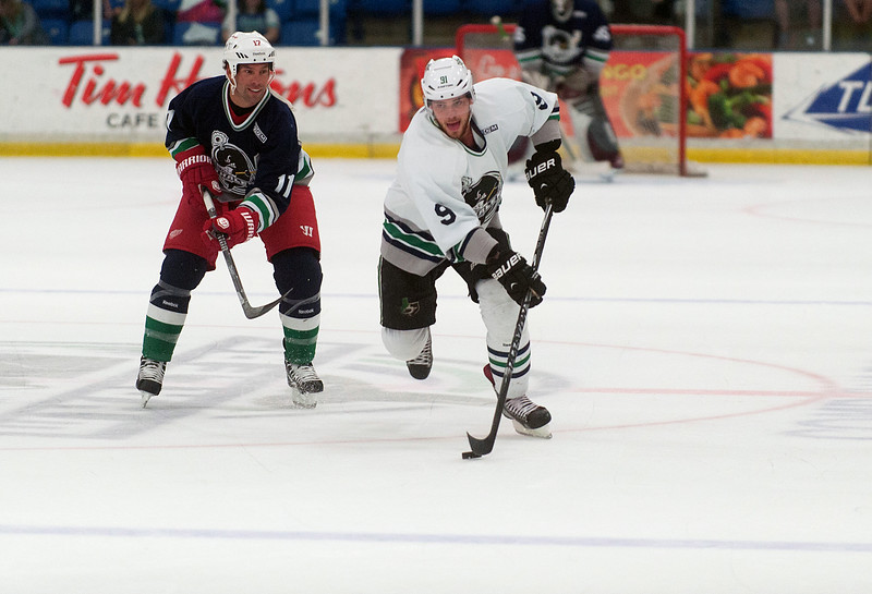 CAPTION INFORMATION Dallas Stars center Tyler Seguin takes the puck past Ottawa Senators center David Legwand during an Alumni Game at Compuware Arena on Aug 16, 2014.  (Mark Bialek / Special to the Det News)
