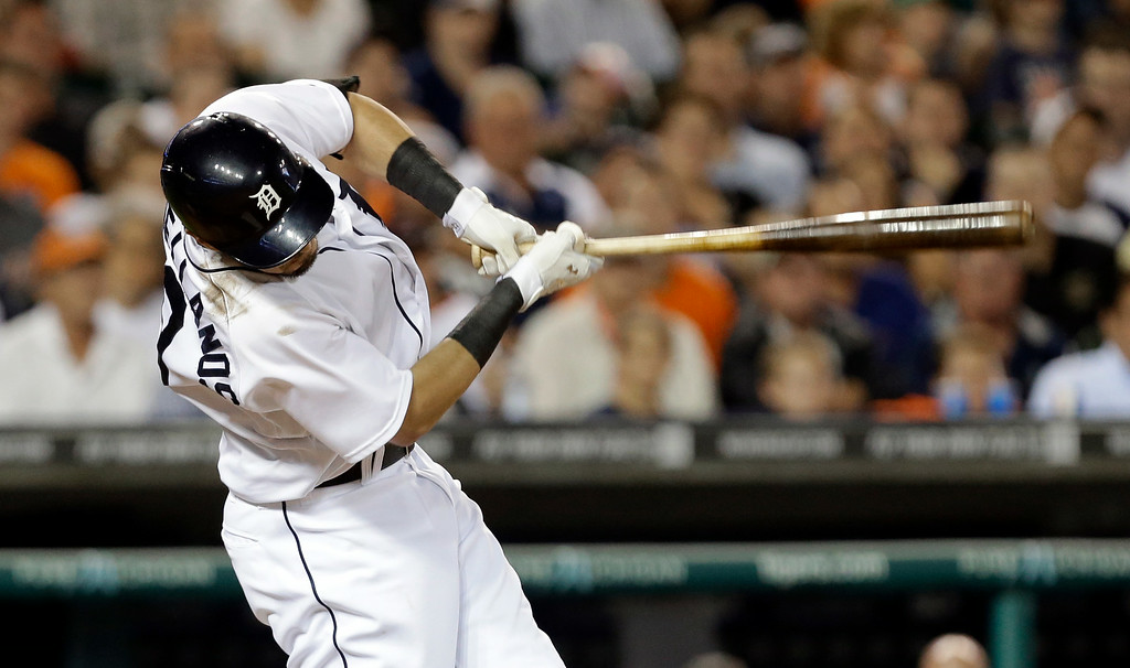 . Detroit Tigers\' Nick Castellanos hits a one-run single against the New York Yankees in the sixth inning of a baseball game in Detroit Tuesday, Aug. 26, 2014. (AP Photo/Paul Sancya)