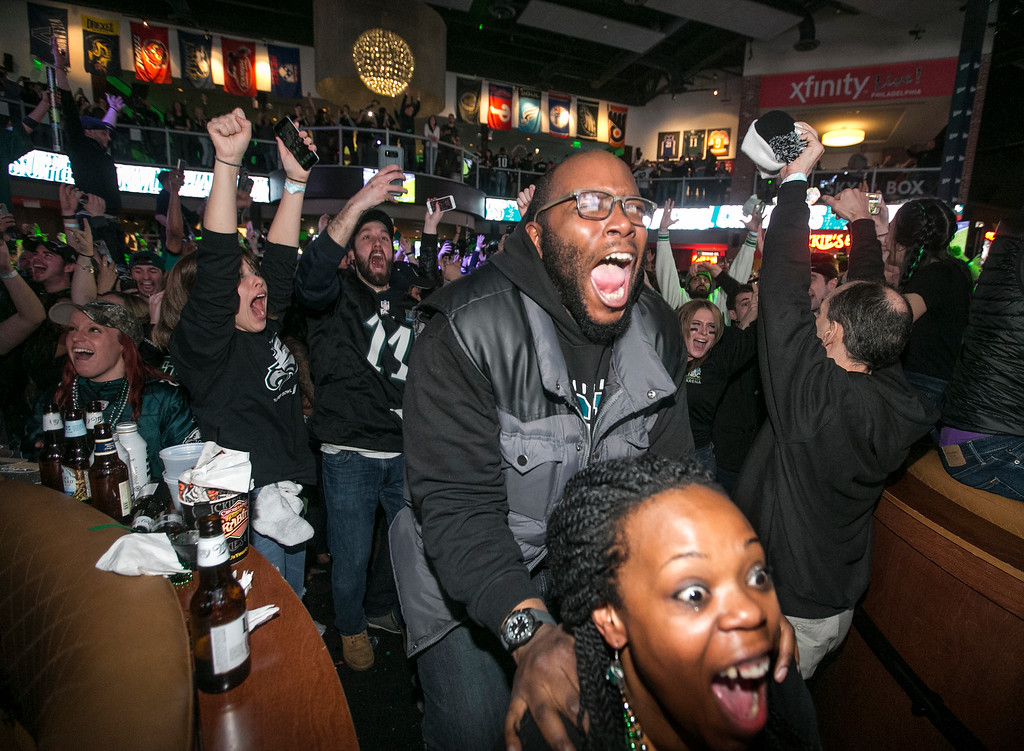 . Fans celebrate at a Super Bowl party at Xfinity Live! in Philadelphia as the Philadelphia Eagles defeated the New England Patriots in the NFL Super Bowl 52 football game on Sunday, Feb. 4, 2018. The Eagles won 41-33. (Charles Fox/The Philadelphia Inquirer via AP)
