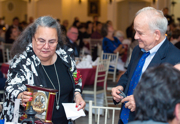09/27/18 Wesley Bunnell | Staff The Immigrant Heritage Hall of Fame 2018 Gala and Induction Ceremonies was held on Thursday night at The Aqua Turf Club. Dr. Daisy Cocco De Filippis places her award on the table as family and friends look on.