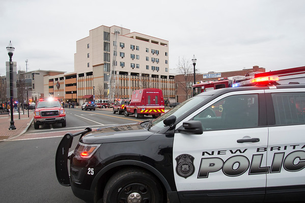 01/31/20 Wesley Bunnell | StaffrrA fire occurred at 40 Chestnut St on Friday afternoon January 31, 2020 requiring one person to be taken by ambulance for smoke inhalation. A police cruiser blocks an intersection near the fire.