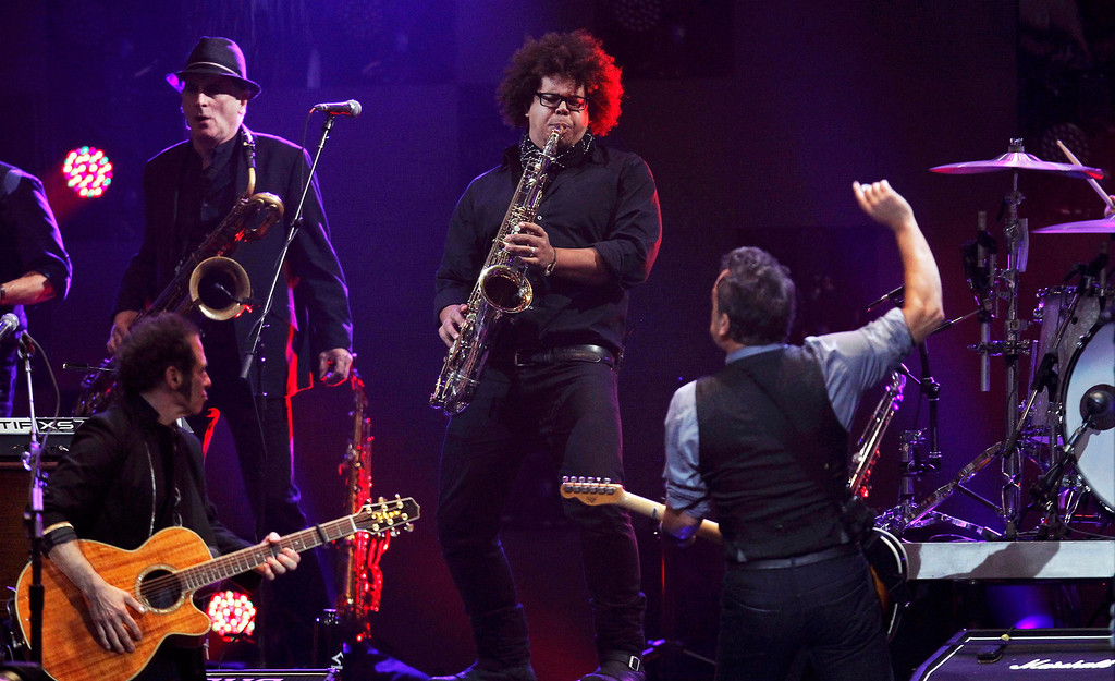 """. Singer Bruce Springsteen (R) performs with Nils Lofgren (L) and Jake Clemons (centre), nephew of the late Clarence Clemons, during the \""""12-12-12\"""" benefit concert for victims of Superstorm Sandy at Madison Square Garden in New York December 12, 2012. REUTERS/Lucas Jackson"""