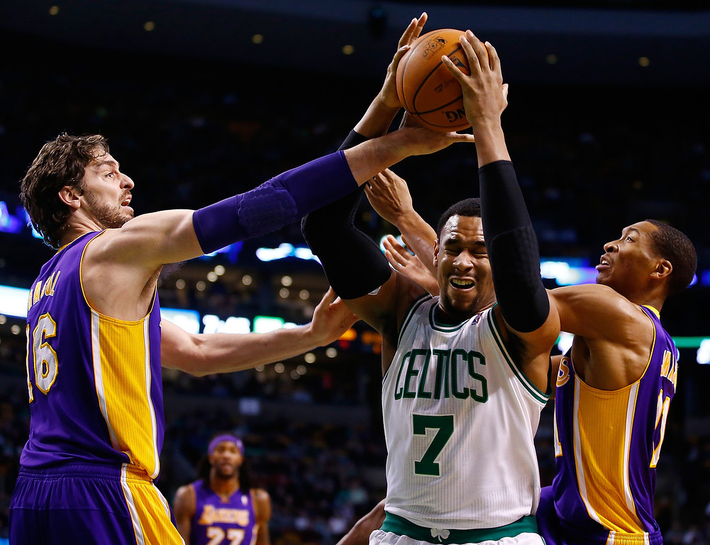 . BOSTON, MA - JANUARY 17: Jared Sullinger #7 of the Boston Celtics fights for a rebound in front of Pau Gasol #16 and Jordan Hill #27 of the Los Angeles Lakers in the first quarter during the game at TD Garden on January 17, 2014 in Boston, Massachusetts.  (Photo by Jared Wickerham/Getty Images)