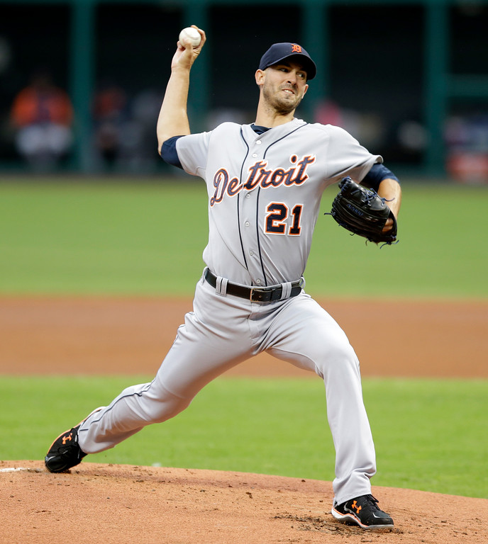 . Detroit Tigers starting pitcher Rick Porcello delivers in the first inning of a baseball game against the Cleveland Indians, Friday, June 20, 2014, in Cleveland. (AP Photo/Tony Dejak)