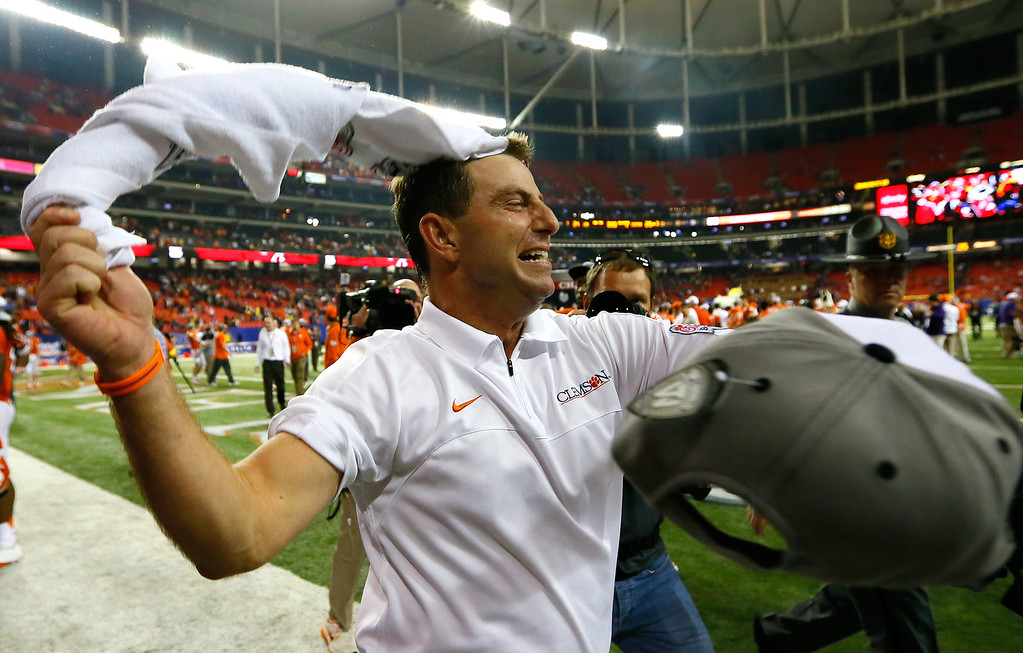 . ATLANTA, GA - JANUARY 01:  Head coach Dabo Swinney of the Clemson Tigers celebrates their 25-24 win over the LSU Tigers during the 2012 Chick-fil-A Bowl at Georgia Dome on December 31, 2012 in Atlanta, Georgia.  (Photo by Kevin C. Cox/Getty Images)