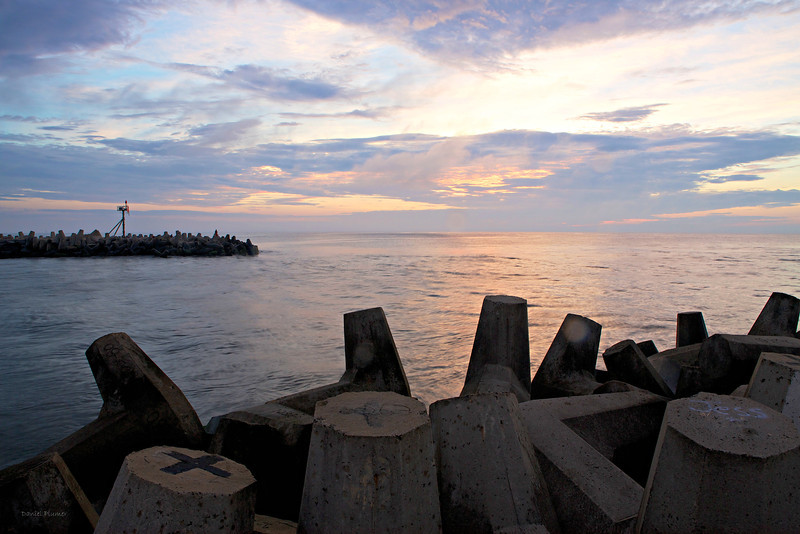 Sunrise At Point Pleasant - taken this morning out on the jetty buttressed with huge cement jax which were covered with graffiti. Nice for this x east coaster to see the sun rise over water.