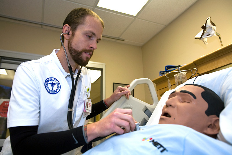 Sacramento City College Extended Campus nursing student Justin Seither participates in a CVA simulation exercise in the SCC/EX sim lab.