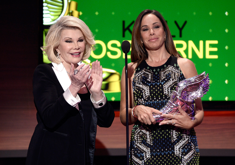 . Television personalities Joan Rivers and Melissa Rivers speak onstage at the DoSomething.org and VH1\'s 2013 Do Something Awards at Avalon on July 31, 2013 in Hollywood, California.  (Photo by Kevin Winter/Getty Images)
