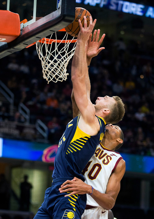 . Indiana Pacers\' Domantas Sabonis (11) shoots past Cleveland Cavaliers\' Edy Tavares (40) during the third quarter of an NBA preseason basketball game, Friday, Oct. 6, 2017, in Cleveland. The Pacers won 106-102. (AP Photo/Scott R. Galvin)