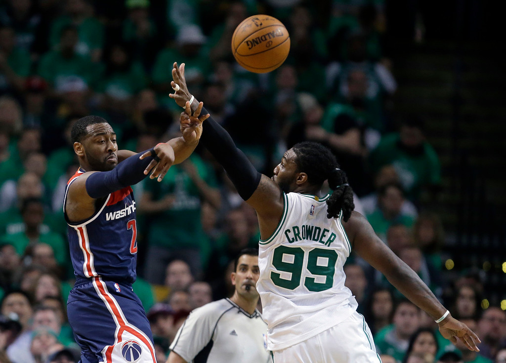 . Washington Wizards guard John Wall, left, delivers a pass as Boston Celtics forward Jae Crowder defends during the second quarter of Game 7 of a second-round NBA basketball playoff series, Monday, May 15, 2017, in Boston. (AP Photo/Charles Krupa)