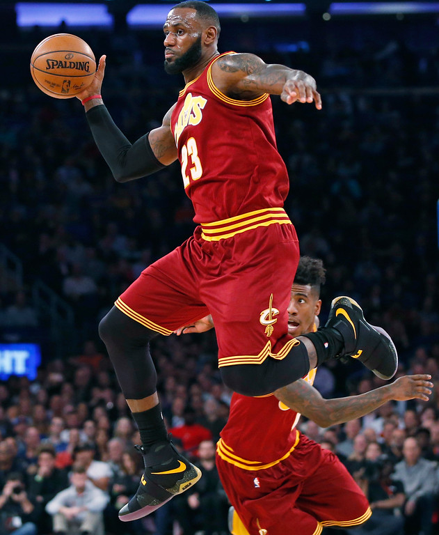 . Cleveland Cavaliers forward LeBron James (23) passes to a teammate in the first quarter of an NBA basketball game at Madison Square Garden in New York, Wednesday, Dec. 7, 2016. Cleveland Cavaliers guard Iman Shumpert (4) backs up the play. (AP Photo/Kathy Willens)