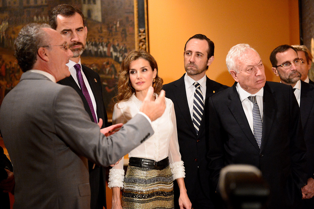 . Professor Steven Hackel, left, shows The Crown Prince Felipe and Princess Letizia of Spain and their Spanish entourage the Junipero Serra exhibition at The Huntington Library in San Marino Saturday night, November 16, 2013. (Photo by Sarah Reingewirtz/Pasadena Star-News)