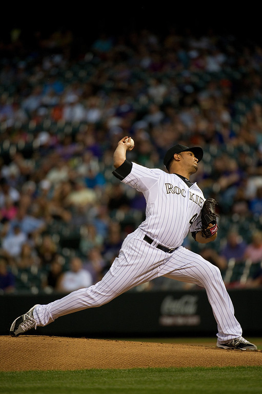 . DENVER - JUNE 28: Jhoulys Chacin #45 of the Colorado Rockies throw a pitch during the first inning of a baseball game against the San Francisco Giants on June 28, 2013 at Coors Field. (Photo By Grant Hindsley / The Denver Post)