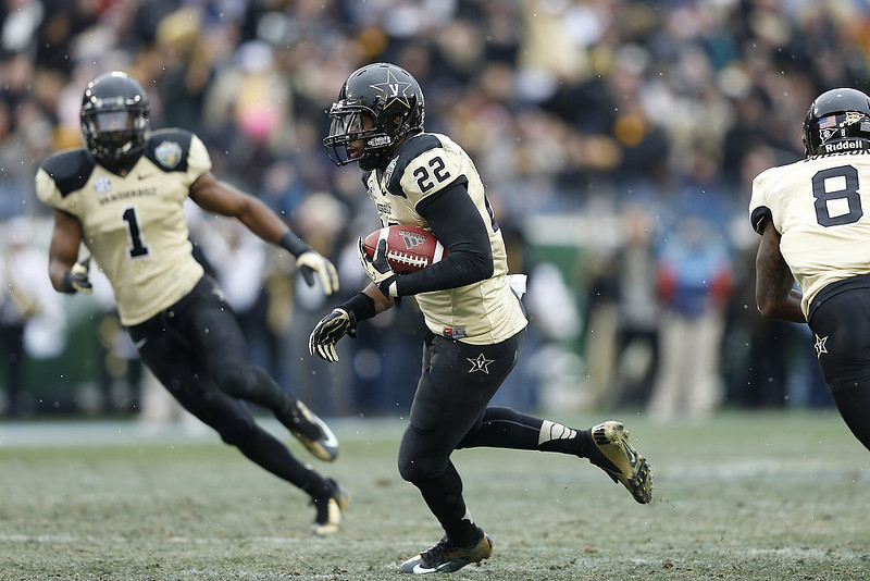 . Eric Samuels #22 of the Vanderbilt Commodores returns the ball after an interception against the North Carolina State Wolfpack during the Franklin American Mortgage Music City Bowl at LP Field on December 31, 2012 in Nashville, Tennessee. (Photo by Joe Robbins/Getty Images)