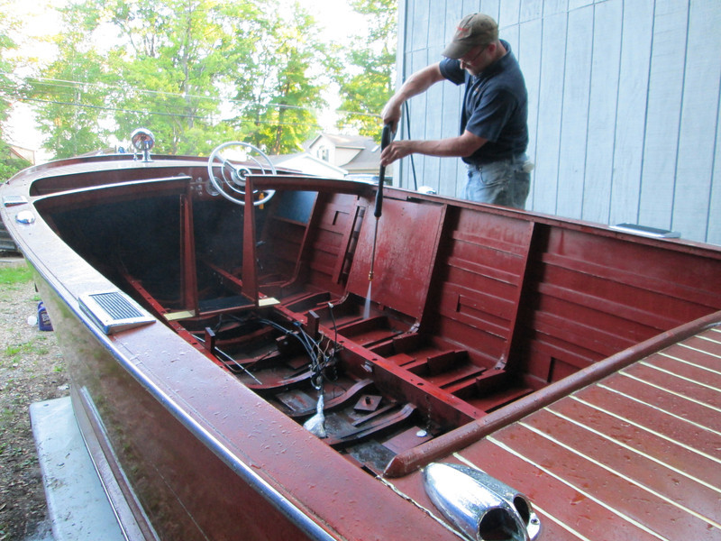 Power washing the inside before we turn the boat up side down.