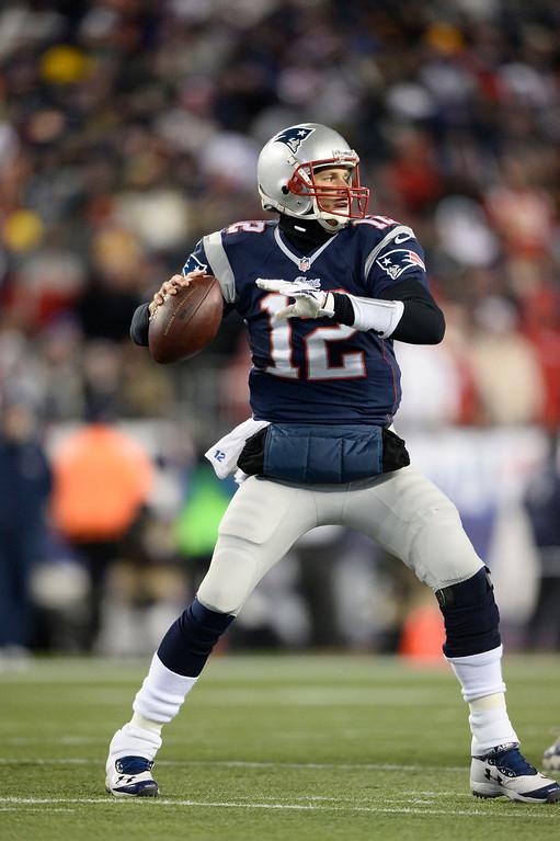 . New England Patriots quarterback Tom Brady (12) drops back to pass during the first quarter against the Denver Broncos November 24, 2013 at Gillette Stadium.  (Photo by John Leyba/The Denver Post)