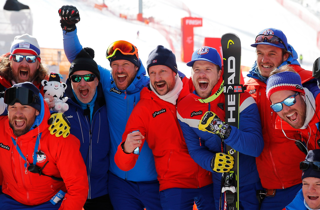 . Crown Prince Haakon of Norway, center, poses for photos flanked by Norway\'s Aksel Lund Svindal, gold, left, and Norway\'s Kjetil Jansrud, silver, right, for the men\'s downhill at the 2018 Winter Olympics in Jeongseon, South Korea, Thursday, Feb. 15, 2018. (AP Photo/Christophe Ena)
