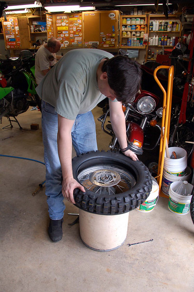 Slade showing how to put a 606 on the rim without tire irons.