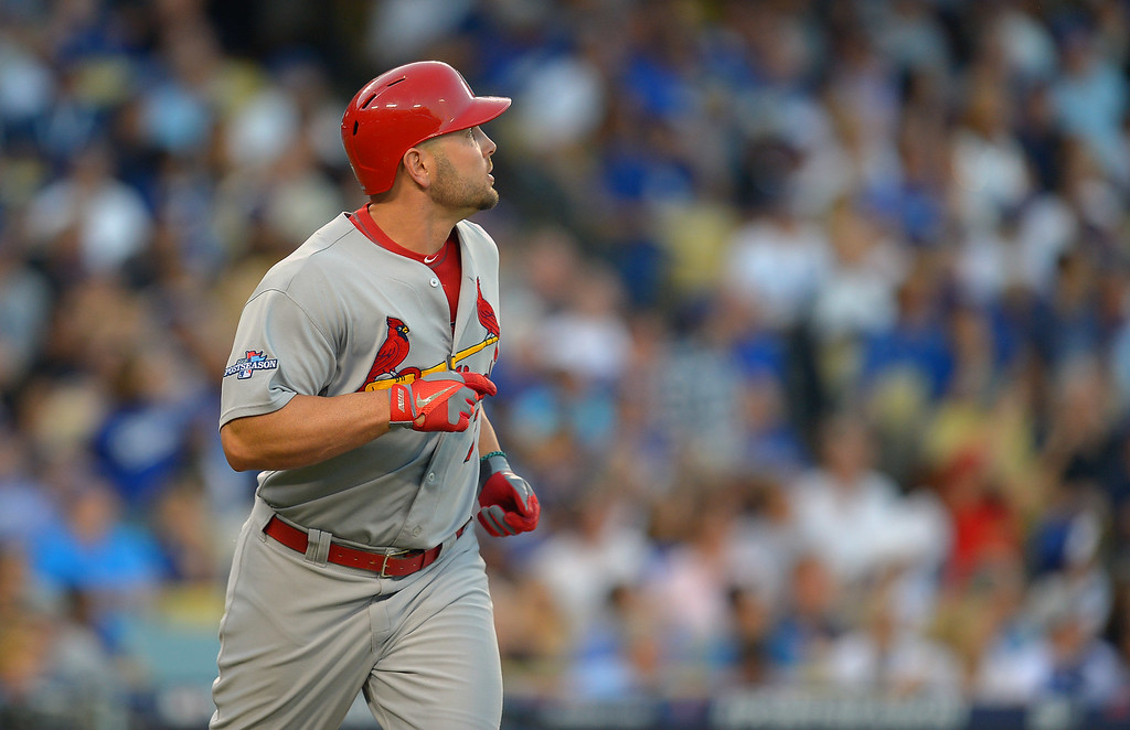. The Cardinals\' Matt Holliday watches his ball head for the fence after hitting a 2-run homer in the 3rd against the Dodgers during game 4 of the NLCS at Dodger Stadium Tuesday, October 15, 2013. (Photo by Andy Holzman/Los Angeles Daily News)