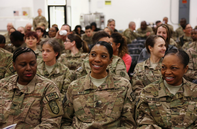 . U.S. forces in Afghanistan, part of the NATO-led International Security Assistance Force (ISAF), celebrate during a gathering marking International Women\'s Day in Kabul, Afghanistan, Saturday, March 8, 2014. (AP Photo/Rahmat Gul)