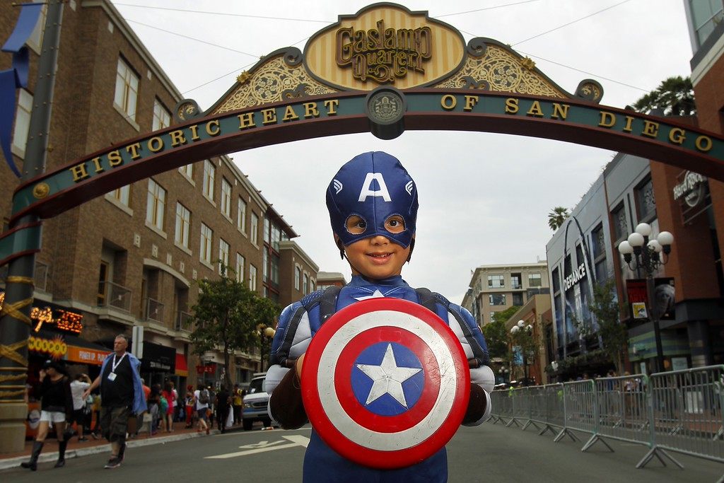 . Atticus Khan poses for a photo dressed as Captain America at Comic-Con, Friday, July 19, 2013, in San Diego. (AP Photo/U-T San Diego, K.C. Alfred)