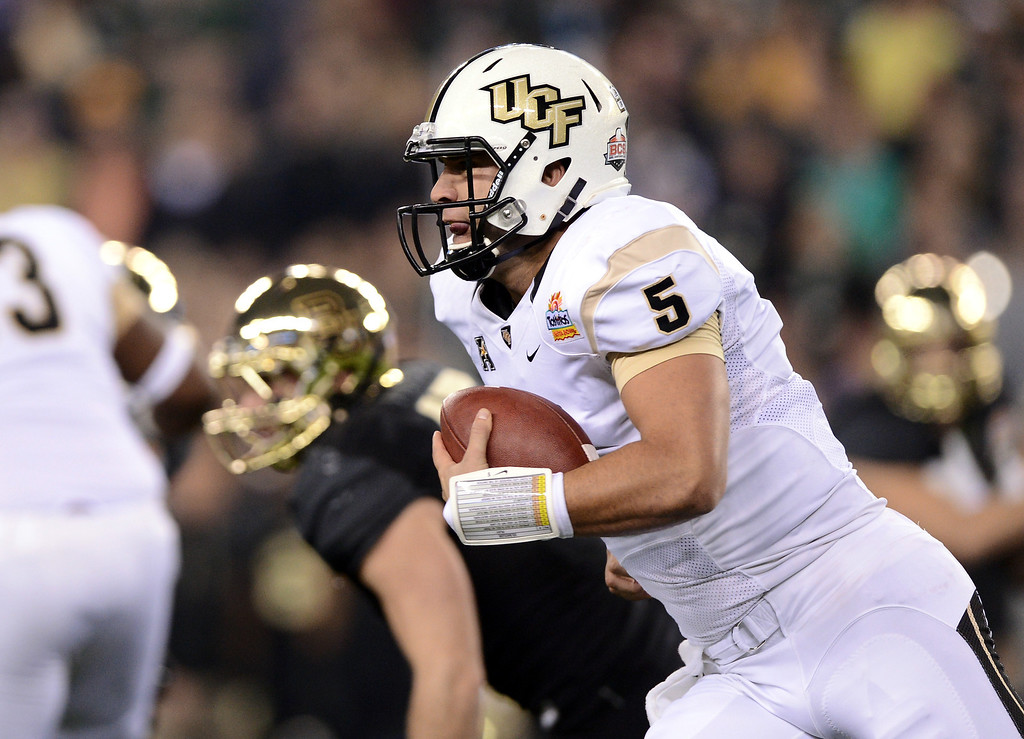 . GLENDALE, AZ - JANUARY 01: Quarterback Blake Bortles #5 of the UCF Knights runs the ball against the Baylor Bears during the Tostitos Fiesta Bowl at University of Phoenix Stadium on January 1, 2014 in Glendale, Arizona.  (Photo by Jennifer Stewart/Getty Images)