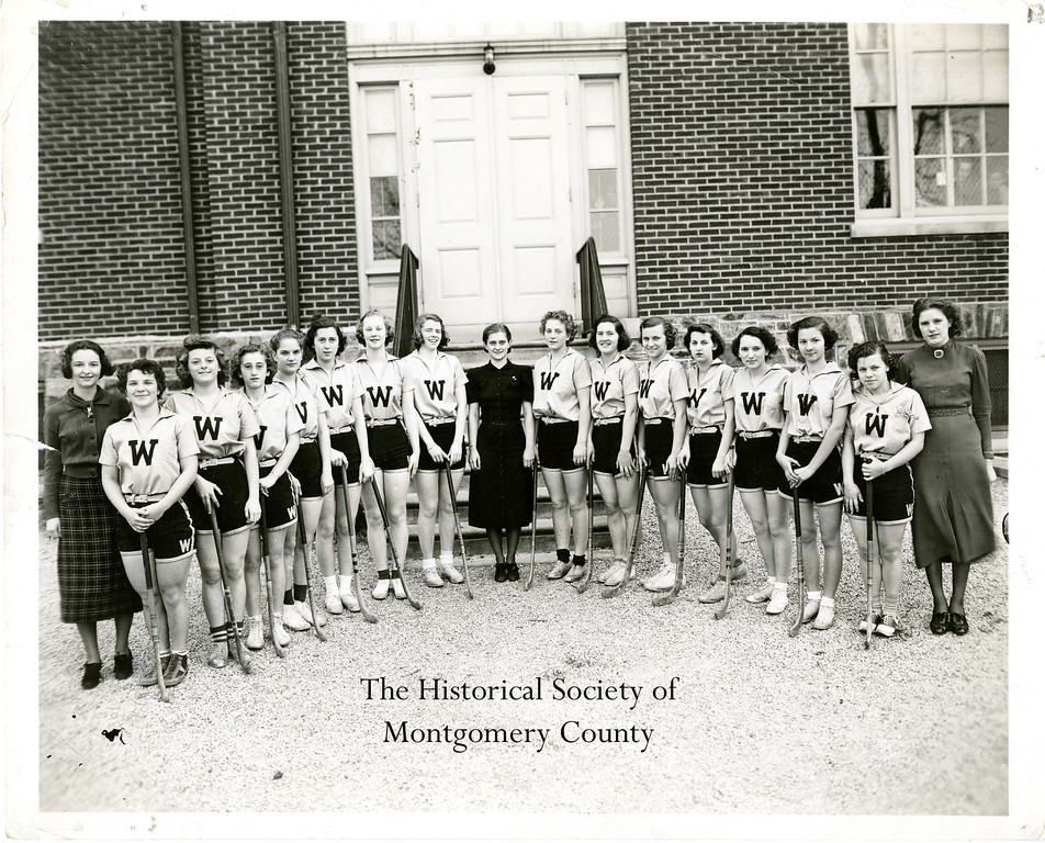 ". This photo from the Historical Society of Montgomery County shows the ""W\"" field hockey team, c. 1950."