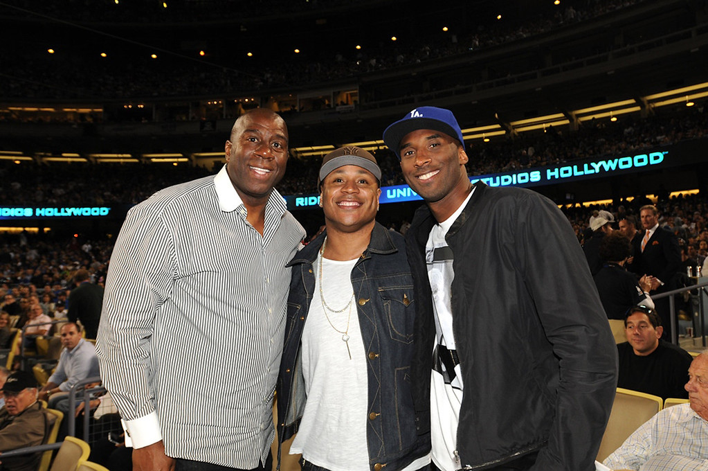 ". (L-R) Earvin ""Magic\"" Johnson, rapper LL Cool J and Kobe Bryant of the Los Angeles Lakers attend a game between the Los Angeles Dodgers and the New York Yankees on July 31, 2013 at Dodger Stadium in Los Angeles, Caifornia. (Photo by Jill Weisledero/Los Angeles Dodgers via Getty Images)"