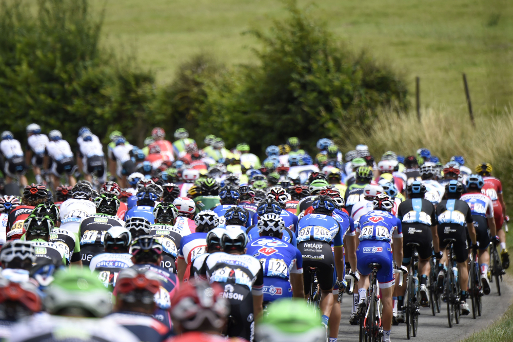 Description of . The pack rides during the 163.5 km fourth stage of the 101st edition of the Tour de France cycling race on July 8, 2014 between Le Touquet-Paris-Plage and Lille, northern France.  (ERIC FEFERBERG/AFP/Getty Images)