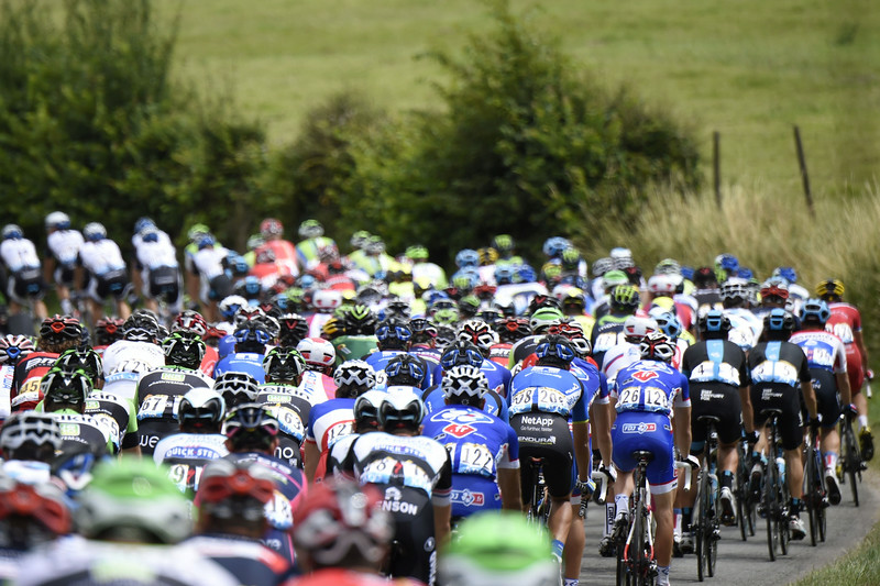 . The pack rides during the 163.5 km fourth stage of the 101st edition of the Tour de France cycling race on July 8, 2014 between Le Touquet-Paris-Plage and Lille, northern France.  (ERIC FEFERBERG/AFP/Getty Images)