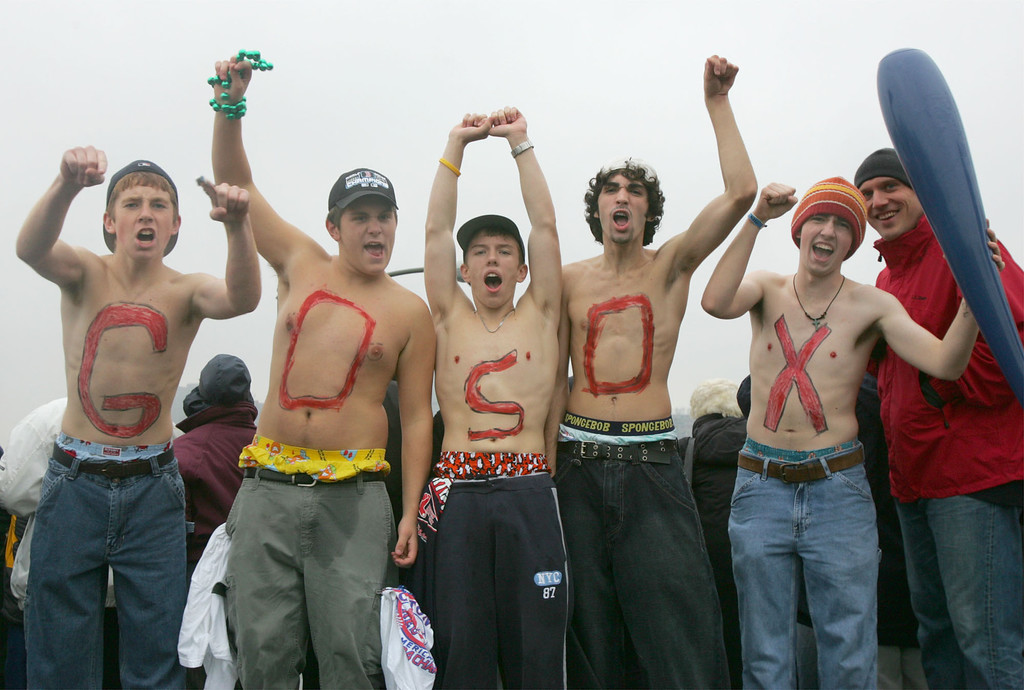 . Boston Red Sox fans from left; Ted Barry of Boston, Chris Early of Boston, Kevin Wallace of Watertown, Mass., Anthony Gentilucci of Boston, and Dan Attridge, of Boston show their support on the Longfellow Bridge on the Cambridge, Mass., side during the Red Sox\'s World Series Championship parade, Saturday, Oct. 30, 2004. (AP Photo/Chitose Suzuki)