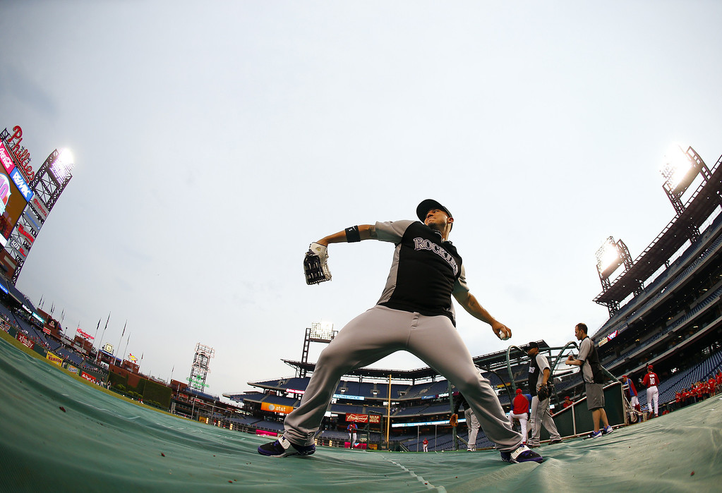 . Carlos Gonzalez #5 of the Colorado Rockies warms up before the start of a game against the Philadelphia Phillies at Citizens Bank Park on May 27, 2014 in Philadelphia, Pennsylvania. (Photo by Rich Schultz/Getty Images)