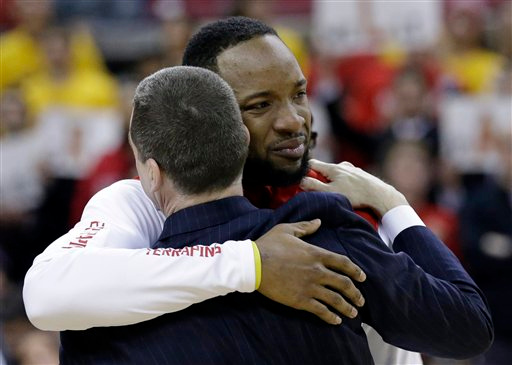 . Maryland guard/forward Dez Wells hugs head coach Mark Turgeon during a senior day ceremony before an NCAA college basketball game against Michigan, Saturday, Feb. 28, 2015, in College Park, Md. (AP Photo/Patrick Semansky)