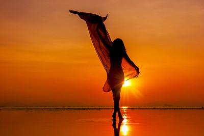 beautiful woman girl on beach with pareo shawl.
