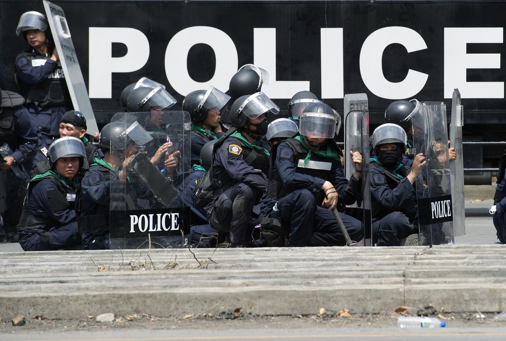 . Thai riot policemen stand guard after demanding protesters to leave the area around the Government House in Bangkok on February 18, 2014.    AFP PHOTO/PORNCHAI KITTIWONGSAKUL/AFP/Getty Images