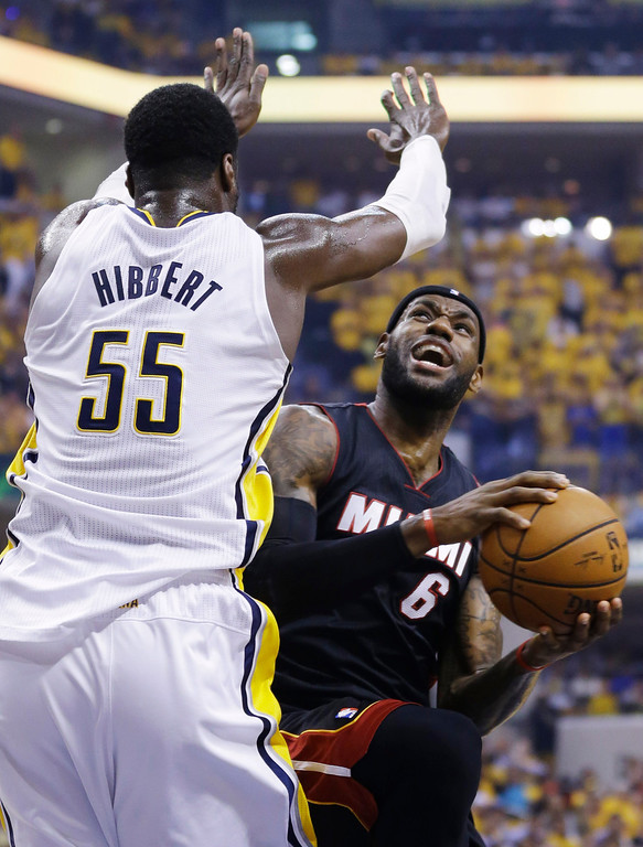 . Miami Heat forward LeBron James (6) looks to shoot over Indiana Pacers center Roy Hibbert (55) during the first half of Game 5 of the NBA basketball Eastern Conference finals in Indianapolis, Wednesday, May 28, 2014. (AP Photo/Michael Conroy)