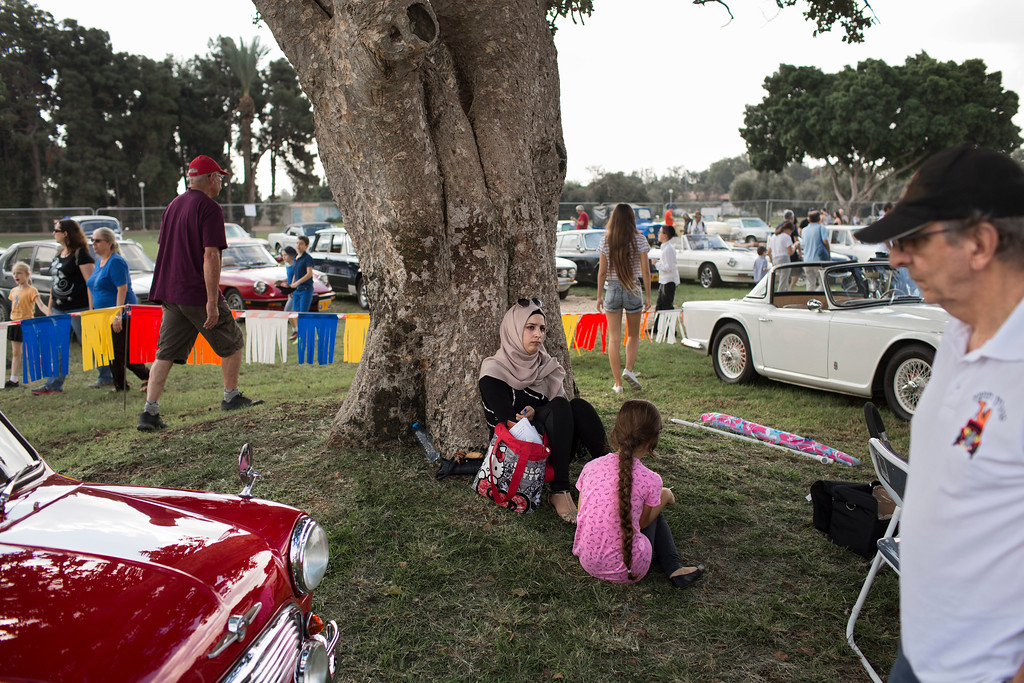 ". People look at antique cars during the 31st annual ""Five Club\"" collectors cars meeting in Ramat Gan, Israel, Friday, Oct. 6, 2017. (AP Photo/Oded Balilty)"