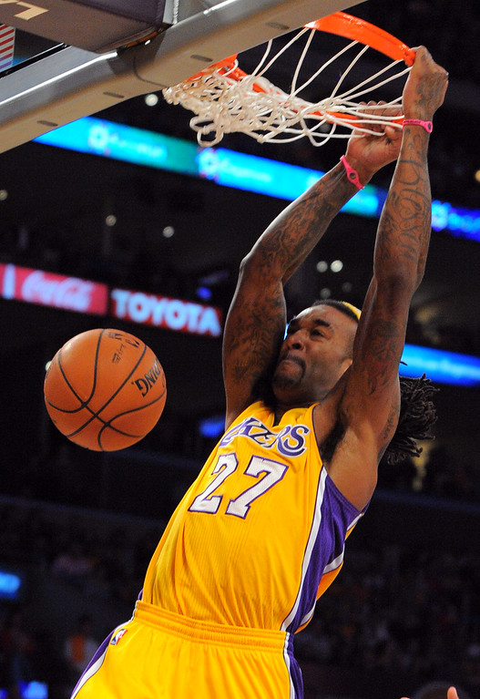 . Lakers Jordan Hill dunks in the first half in the NBA season opener between the Lakers and Clippers at Staples Center in Los Angeles, CA on Tuesday, October 29, 2013.   (Photo by Scott Varley, Daily Breeze)