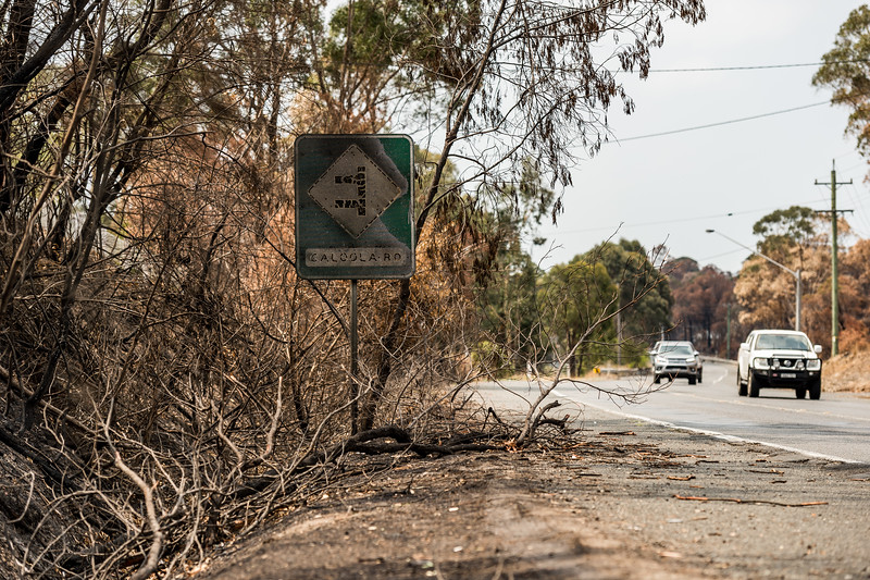 Old Hume Highway, AUSTRALIA - JANUARY 14: A road sign damaged by bush fire off the Old Hume Highway, NSW.