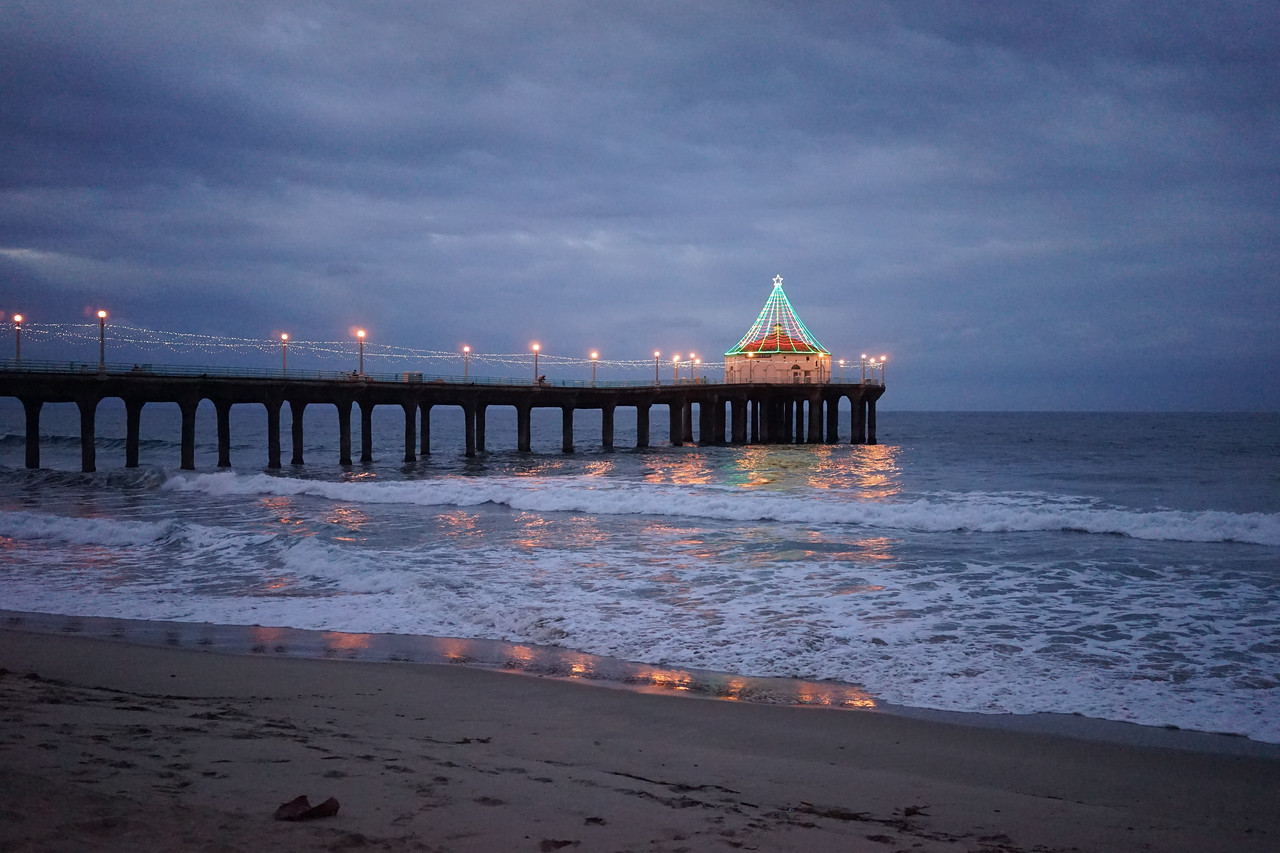 During the holidays. the coty of Manhattan Beach decks the Roundhouse on the Pier with holiday lights. They are still lit in the mornings, and generally get turned off around 6 a.m.This shot was taken at 5:45 a.m.
