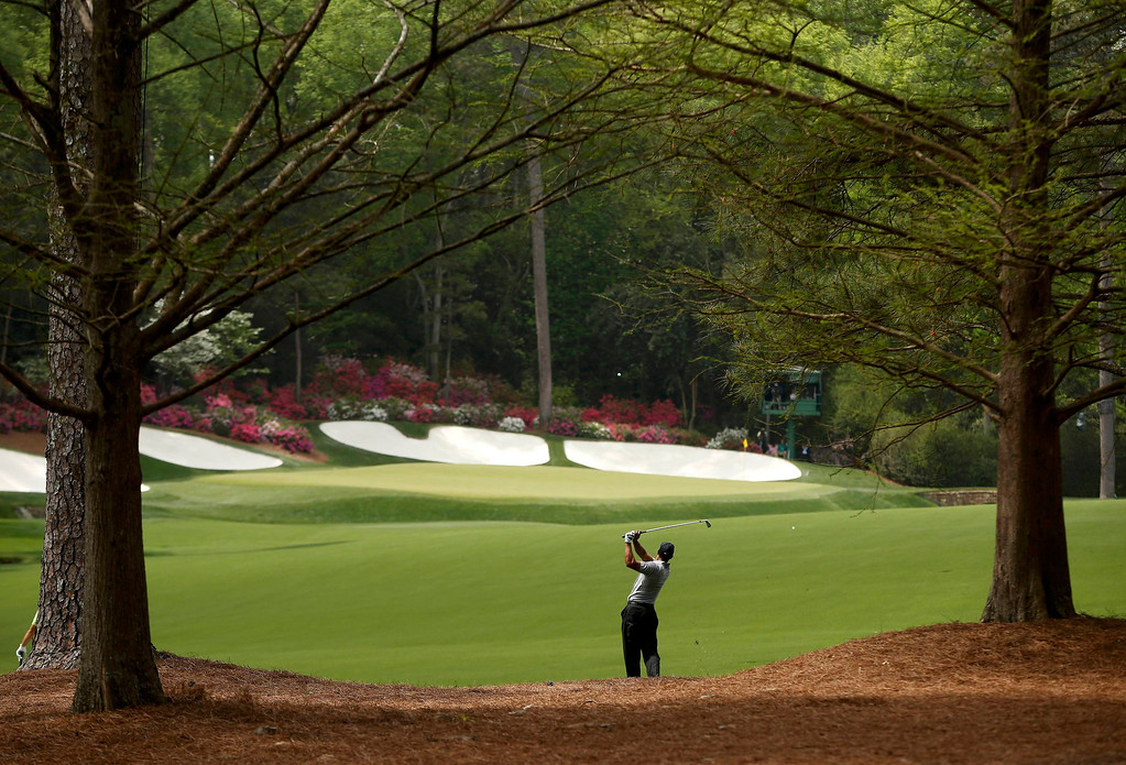 . Tiger Woods of the U.S. hits his approach shot to the 13th green during first round play in the 2013 Masters golf tournament at the Augusta National Golf Club in Augusta, Georgia, April 11, 2013.   REUTERS/Mark Blinch