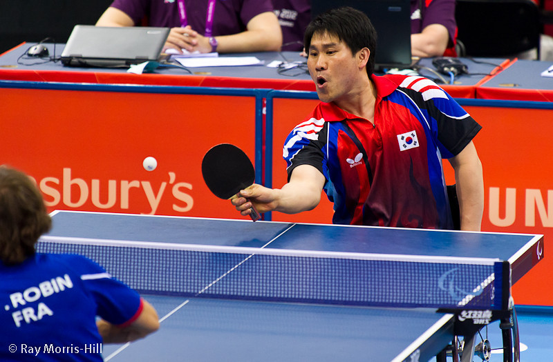 Table Tennis at Excel, 7 September 2012. Jeon Seok Kim and Jean-Phillippe Robin in the Men's Team Bronze Medal match (Class 3) between South Korea and France.  France won 3-1