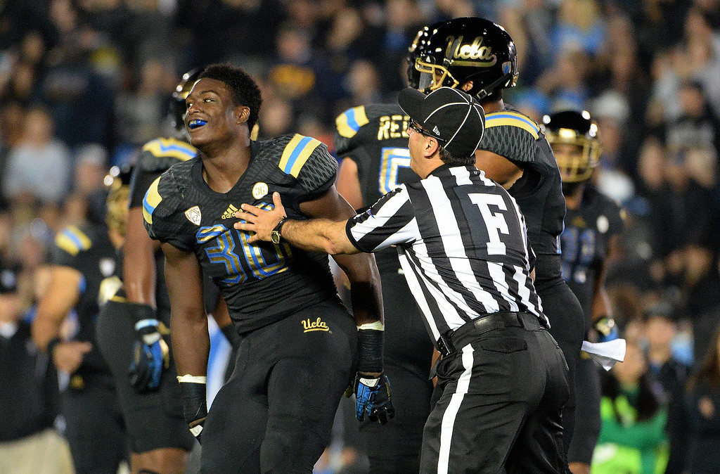 . UCLA Bruin running back Myles Jack (30) reacts after scoring one of his four touchdowns against Washington Huskiesw during the first half of their college football game in the Rose Bowl in Pasadena, Calif., on Friday, Nov. 15, 2013.   (Keith Birmingham Pasadena Star-News)