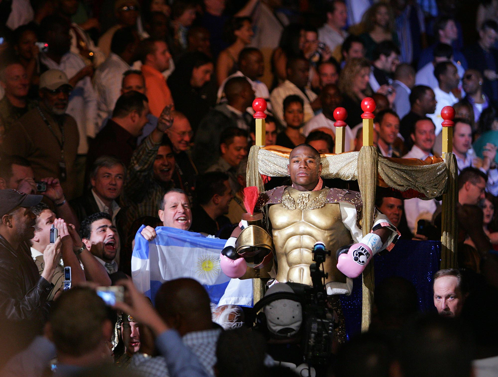 . Floyd Mayweather Jr. is carried into the ring just before the start of his bout with Carlos Baldomir of Argentina during their WBC Welterweight Championship boxing match, Saturday Nov. 4, 2006, at The Mandalay Bay Resort & Casino in Las Vegas. Mayweather won by unanimous decision. (AP Photo/Eric Jamison)