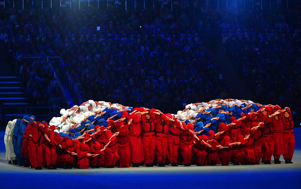 . Dancers form a \'fluttering\' Russian flag during the Opening Ceremony of the Sochi 2014 Paralympic Winter Games at Fisht Olympic Stadium on March 7, 2014 in Sochi, Russia.  (Photo by Ronald Martinez/Getty Images)