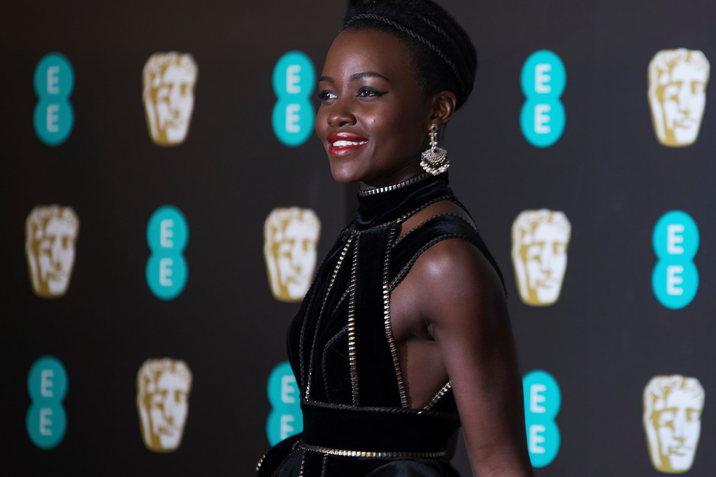 . Lupita Nyong\'o poses for photographers upon arrival at the BAFTA Awards 2018 in London, Sunday, Feb. 18, 2018. (Photo by Vianney Le Caer/Invision/AP)