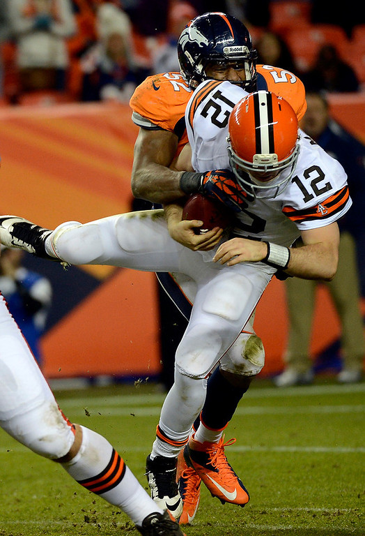 . Denver Broncos outside linebacker Wesley Woodyard (52) sacks Cleveland Browns quarterback Colt McCoy (12) during the fourth quarter. The Denver Broncos vs Cleveland Browns at Sports Authority Field Sunday December 23, 2012. Joe Amon, The Denver Post